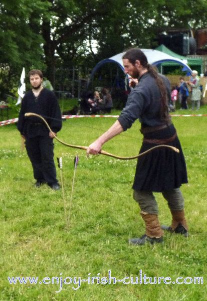 Medieval Ireland- Irish warrior with the special shaped Irish bow and arrows with metal tips, reenacted by Eireann Edge.