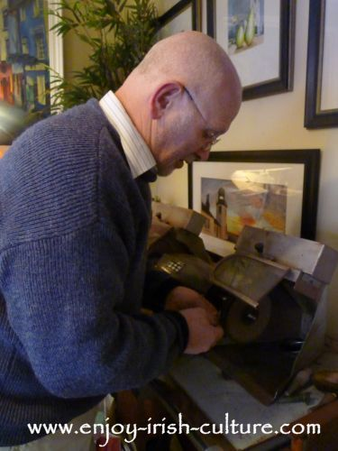 A Claddagh ring being polished at the original Claddagh ring shop, Galway, Ireland, by Johnathan Margetts, proprietor.