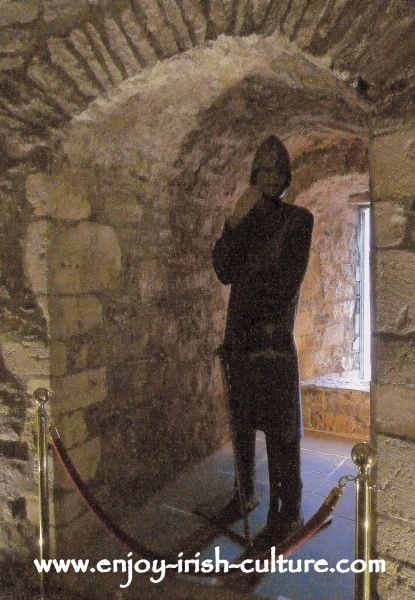 Medieval Norman knight and arrow loop window in the medieval room of the castle.