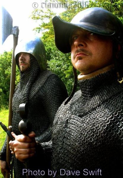 Galloglaigh warriors of medieval Ireland wearing typical helmets and carrying their traditional weapons.