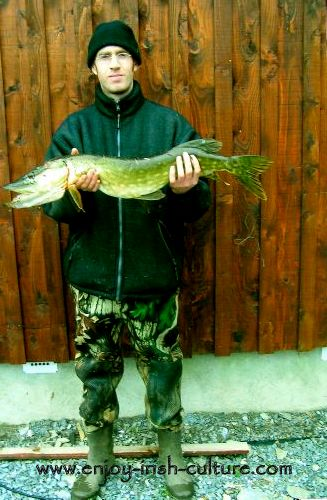 Colm with a great catch of pike.