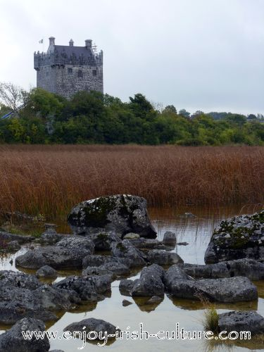 Annaghdown Castle, County Galway, Ireland, summer, seen from the lakeshore.