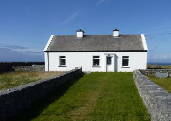 The Inishmore cottage of Peter Conneelly, dry stone builder who died at the age of 106 in 2011. This photo shows the house that he built himself where he raised his family of nine daughters.