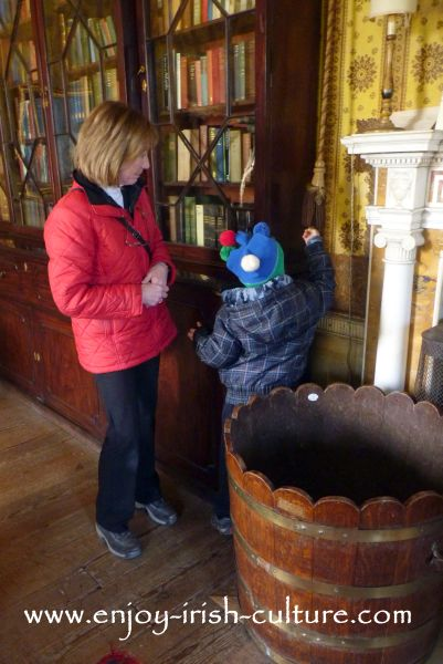 In the drawing room at Strokestown Park House, County Roscommon, Ireland, where our six year old son is getting ready to ring the servant's bell.