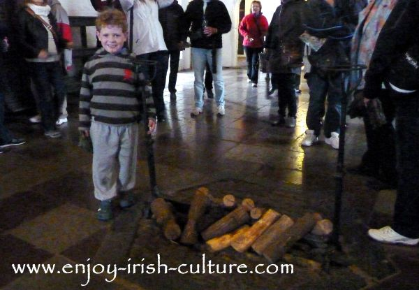 The central fireplace in the Great Hall at Bunratty Castle, County Clare, Ireland.