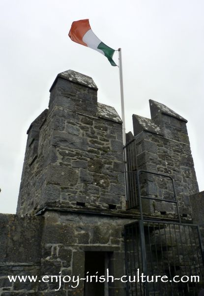 Irish flag on the turretts of Bunratty Castle, County Clare, Ireland