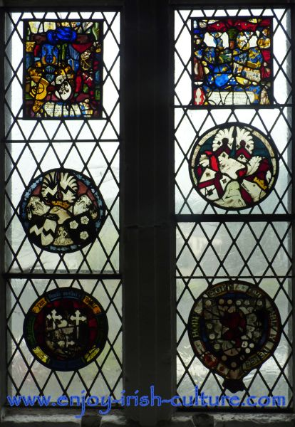 A stain glass window at Bunratty Castle, County Clare, Ireland shows heraldic symbols of medieval owners of this Irish castle.