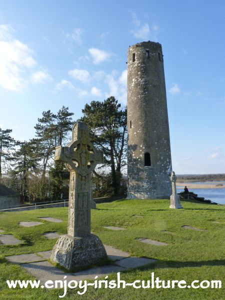 Clonmacnoise, County Offaly, Ireland, Replica of the Cross of the scriptures and round tower.