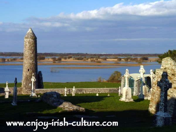 Clonmacnoise, McCarthy's tower and the river Shannon, County Offaly, Ireland.