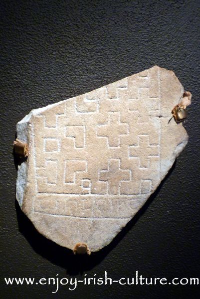 Remnants of a grave marker stone found at Clonmacnoise, County Offaly, and displayed in the museum there. Clonmacnoise was the most important medieval Irish monastery.