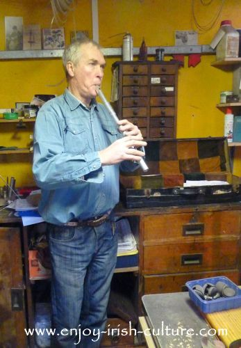 Irish musician and instrument maker Eugene Lambe playing a low whistle.