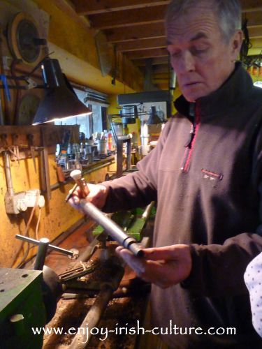 Eugene Lambe making a chanter for a set of uilleann pipes.