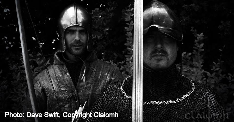 Galloglaigh warriors of medieval Ireland carrying a bow and sword.