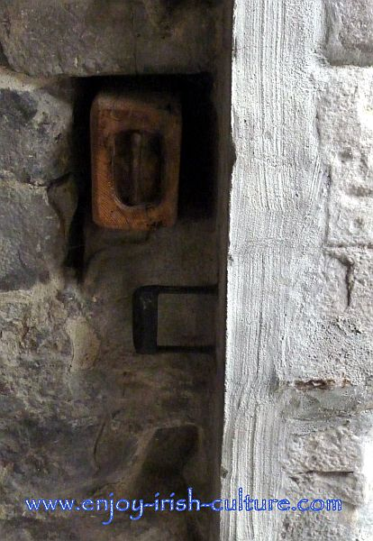 Beam used to secure the entrance door at Claregalway Castle, County Galway, Ireland.