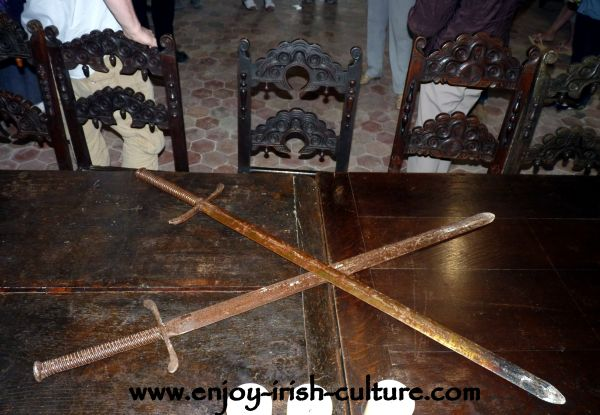 Swords on the table of the great hall at Claregalway Castle, County Galway, Ireland.