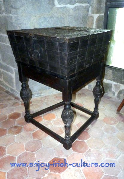 14th century tithe box, retrofitted with legs, on show at Claregalway Castle, County Galway, Ireland.