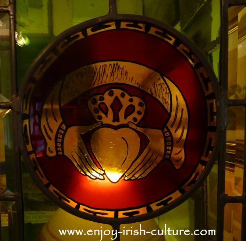 The Claddagh symbol in stained glass at Dillon's Jewellers Shop on Quay Street, Galway, Ireland, who are the oldest makers of the ring anywhere.