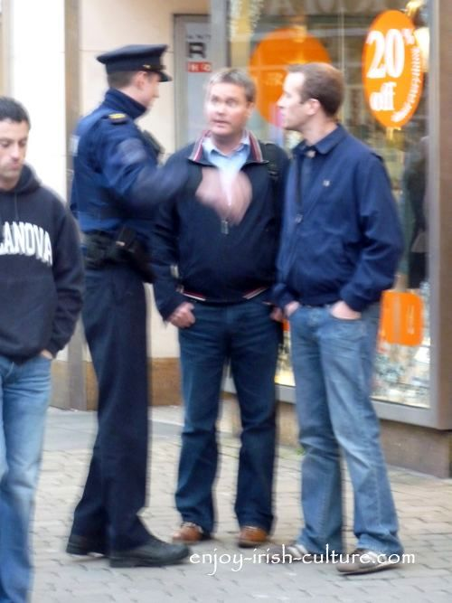 Gardai chatting to people in the street.