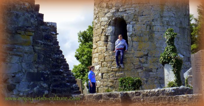 Local kids playing in the round tower of the monastic site at Aghagower, County Mayo, Ireland.