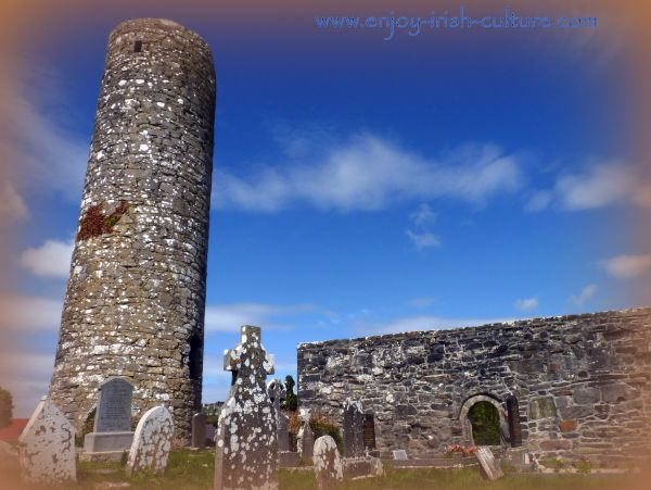 Church and round tower at Aghagower, County Mayo, Ireland.