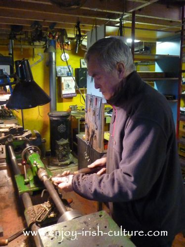 Well known uilleann piper and instrument maker Eugene Lambe in his workshop in Kinvara, County Galay, Ireland.