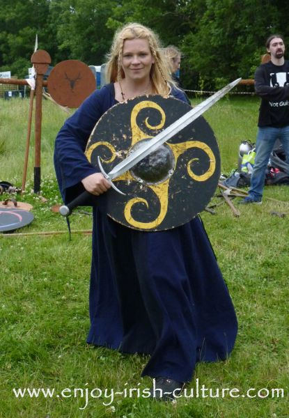 Medieval Ireland-female Irish warrior with sword and wooden shield, reenacted by Eireann Edge.