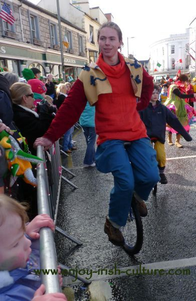 St Paddy's Day Parade Galway 2013, unicyclist taking a break