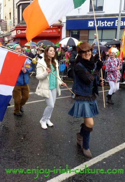 St Paddy's Day Parade Galway 2013, dancers with multinational flags