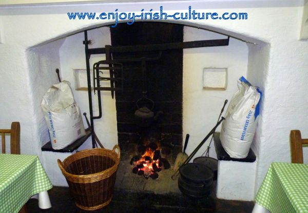 The hearth of the Irish cottage, now the coffee shop at the outdoor heritage museum of Craggaunowen at Quin, County Clare, Ireland.