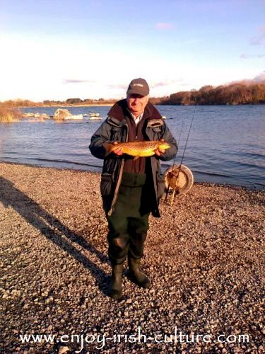 Kevin with a golden brown trout from Lough Corrib, County Galway, Ireland.