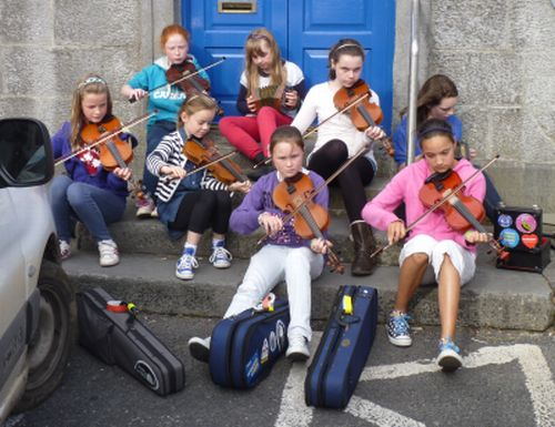 Irish traditional music played in the street during a spontaneous session at Tulla Trad, County Clare, Ireland.