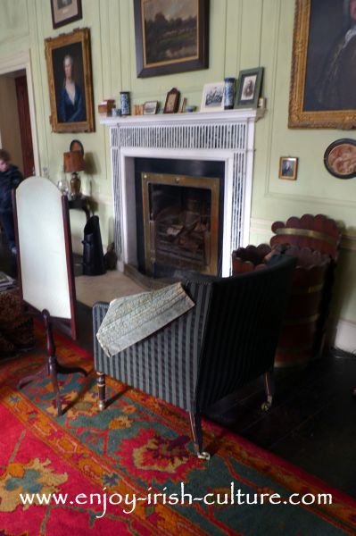 The fireplace in the drawing room at Strokestown Park House, County Roscommon, Ireland- the place for the ladies to gather after an elaborate dinner.