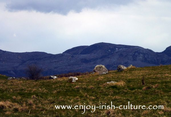 Monument with a view of the Ox Mountains in the background. County Sligo, Ireland, is one the best places to visit if you want to meet ancient Ireland.