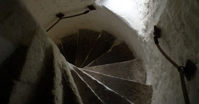 Narrow defensive stairs at Cahir Castle, County Tipperary, Ireland.