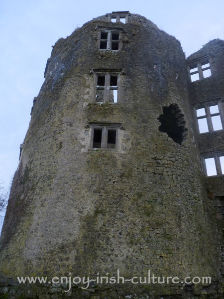 Roscommon Castle, Ireland- close up of a tower with added mullion windows.