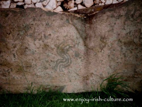 Kerb stone around the perimeter of the tomb at Newgrange, Ireland.