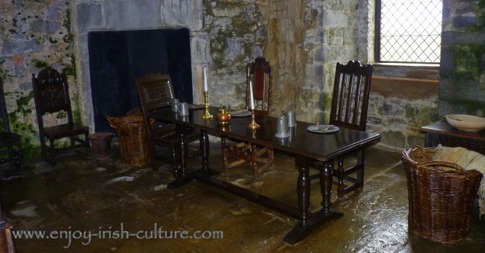 The table is set medieval-style at the castle's dining room.