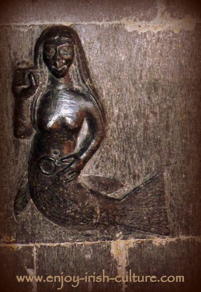 Mermaid carving inside Clonfert Cathedral, a remarkable Irish heritage site in County Galway, Ireland.