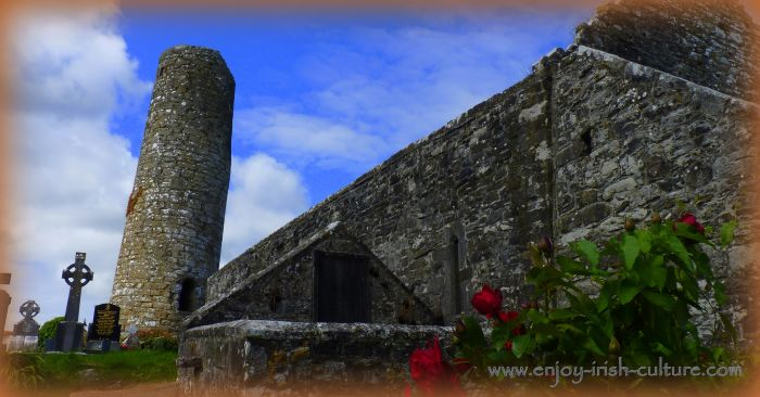 Round tower and medieval church at Aghagower, County Mayo, Ireland.