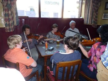 Irish Folk Music session at Minogues Pub in Tulla, County Clare, Ireland.