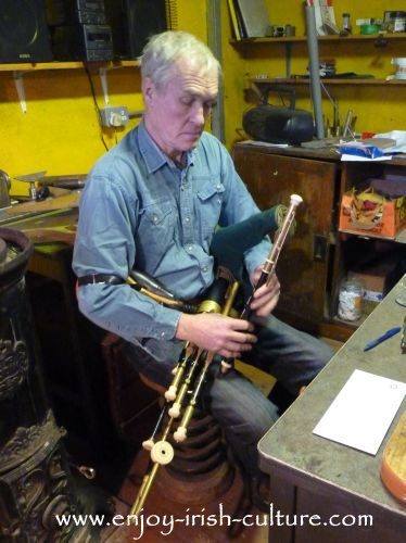 Irish musician and instrument maker Eugene Lambe, playing the uilleann pipes at his workshop in Kinvara, County Galway, Ireland.