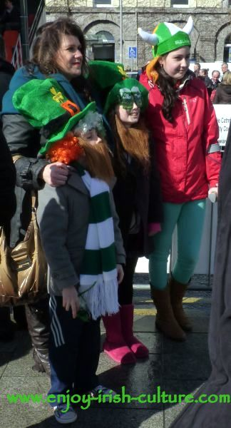 St Patricks Day in Ireland, a family posing to have their picture taken